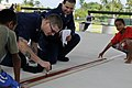 US Navy 100727-N-7280V-398 Information Systems Technician 1st Class Nicholas Delgado, left, and Logistics Specialist 2nd Class Riad Taha paint a basketball court during a community service project for Peleliu Elementary School.jpg