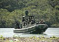 US Navy 100825-N-9806M-056 Sailors and Marines prepare to storm the beach during the pursuit of three suspected drug traffickers during a PANAMAX 2010 riverine training exercise.jpg