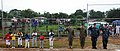 US Navy 100924-N-4153W-121 Navy and Marine Corps leaders render honors during the U.S. national anthem at a newly constructed baseball field.jpg