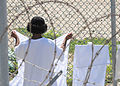 US Navy 101101-F-0651R-036 A detainee hangs his laundry in the recreation area of Camp Four at Joint Task Force Guantanamo.jpg