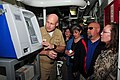 US Navy 110316-N-HC601-088 Capt. David Pimpo demonstrates the use of a Navy Cash machine to a group from the Department of the Treasury aboard USS.jpg