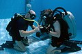 US Navy 110323-N-OT964-015 Navy divers assigned to Mobile Diving and Salvage Unit (MDSU) 2, check their gauges during a training dive.jpg
