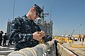 US Navy 110401-N-NL541-056 Electronics Technician 3rd Class Dino Ramic, assigned to the guided-missile frigate USS Boone (FFG 28), ties a line befo.jpg