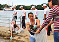 US Navy 110718-N-WJ771-126 Sailors assigned to Commander, Fleet Activities Sasebo help Japanese nationals remove trash from Kashimae Beach during a.jpg