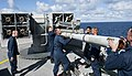 US Navy 111118-N-DX615-059 Fire controlmen load a RIM-7P NATO Sea Sparrow missiles into a Mk 29 Sea Sparrow launcher.jpg