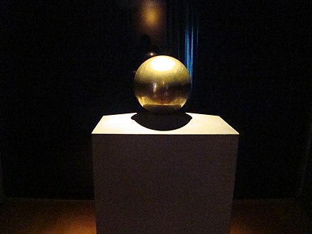 Gilded urn with Tesla's ashes, in his favorite geometric object, a sphere (Nikola Tesla Museum, Belgrade) Urn with Teslas ashes.jpg