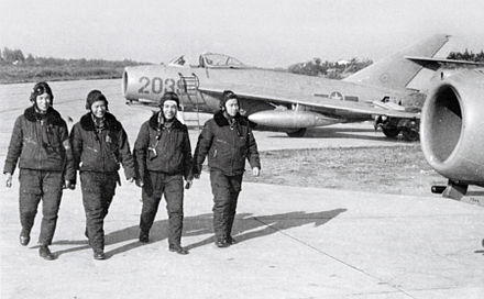 North Vietnamese Air Force pilots walk by their aircraft, the MiG-17. The development of the North Vietnamese Air Force during the war was assisted by Warsaw Pact nations throughout the war. Between 1966 and 1972 a total of 17 flying aces was credited by the NVAF against US fighters. VPAF pilots with MiG-17s.jpg