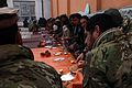 Villagers, Afghan National Police and coalition special operations forces members sit along with elders and Afghan Local Police during a shura in Pul-e Khumri district, Baghlan province, Afghanistan, Feb 120210-A-BT925-026.jpg