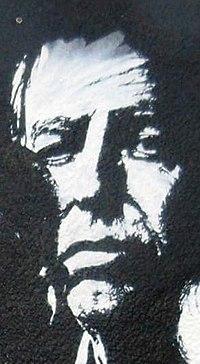 Visage de Bernard Maris sur une fresque d'hommage à Charlie Hebdo.jpg