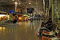 Waiting for a train at Manchester Piccadilly, March 2012.jpg
