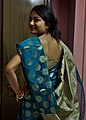 Wearing traditional sari (8956592348).jpg