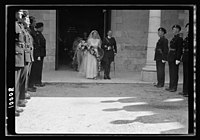 Wedding of Miss Olwen Wainright. The bride & groom, Mr. Walter Peter Purcell-Gilpin coming out from the church followed by bride's maids after the ceremony, showing guard of honour by Br. LOC matpc.18886.jpg
