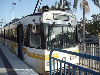 Blue Line (Los Angeles Metro) - Metro Blue Line train heading to Long Beach arrives at Willow Street station.