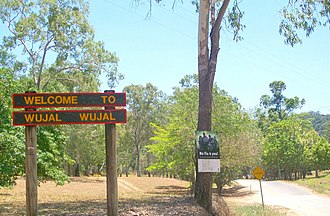 Wujal Wujal - Sign welcoming people to Wujal Wujal, having travelled from the south along the Bloomfield Track