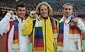 XIX Commonwealth Games-2010 Delhi Winners of (Pole Vault Men's), Steve Hooker of Australia (Gold), Steven Lewis of England (Silver) and Max Eaves of England (Bronze), during the medal ceremony of the event.jpg