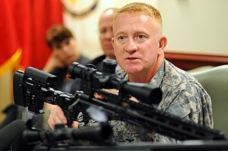 M2010 Enhanced Sniper Rifle - U.S. Army project manager for new weapons Colonel Douglas Tamilio with XM2010 in 2010
