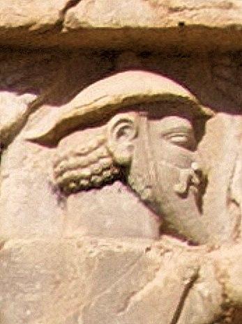 Xerxes I tomb Ionian with petasos or kausia