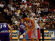 Yao shoots a free throw with John Stockton in the background