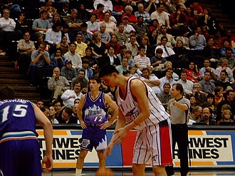 Yao Ming - Yao prepares to shoot a free throw with John Stockton in the background