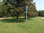 Yardage sign at Lochness Park disc golf course.JPG