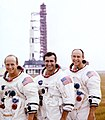 (Left to right) Pete Conrad, Dick Gordon, and Al Bean pose with the Apollo 12 Saturn V.jpg
