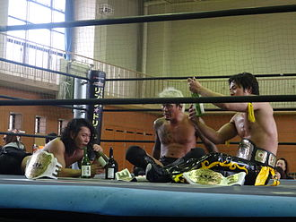 KO-D 6-Man Tag Team Championship - Current and record seven-time KO-D 6-Man Tag Team Champions, Shuten-dōji, with the title belts in May 2014