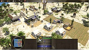 Real-time strategy - Screenshot from the game 0 A.D., showing typical RTS interface elements such as a resource overview (top left), a map of the game world (bottom left), and a description of the selected unit (bottom center).