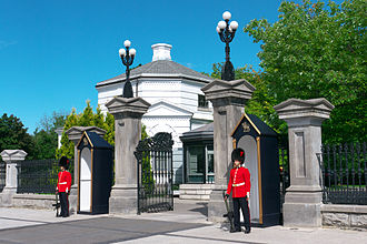 Public duties - Two Canadian Grenadier Guardsmen standing watch at Rideau Hall, an official residence for the Monarch, and the Governor General.
