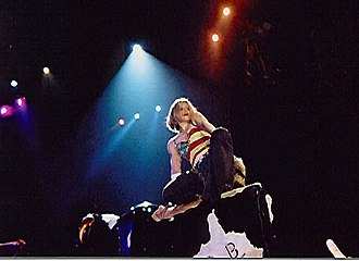 """Human Nature (Madonna song) - Madonna performing """"Human Nature"""" on the Drowned World Tour, while riding a mechanical bull."""