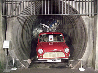 The Italian Job - A display of Mini emerging from a sewer tunnel in Coventry Transport Museum