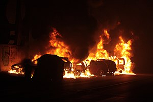 Viareggio train derailment - Some cars parked near the railway line burn