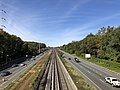 2018-10-25 11 49 53 View west along Interstate 66 (Custis Memorial Parkway) and the Orange and Silver lines of the Washington Metro from the overpass for North Ohio Street in Arlington County, Virginia.jpg