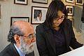 30-07-2009 Diputado Enrique Accorsi Opazo en su oficina, en primer plano de perfil, observa documento junto a asistente..JPG