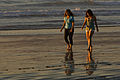 A Mother Daughter team (presumably) walk barefoot together on the beach.jpg