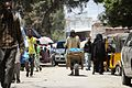 A Somali man walks down the street in Mogadishu's Hamar Weyne market on October 3. Ahead of Eid al-Adha, which begins this evening, many of Mogadishu's residents have been out preparing for the (15241045587).jpg