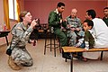 A U.S. Soldier with the Utah State Medical Command, Utah Army National Guard blows bubbles for a Moroccan child as another Soldier provided medical aid for a Moroccan villager at a humanitarian civil assistance 120418-A-QD330-166.jpg