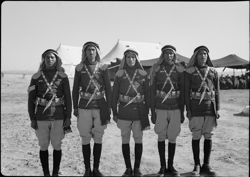 A tribal lunch at cavalry post at Tel-el-Meleiha, 20 miles North of Beersheba, Jan. 18, 1940. Members of Camel Corps standing at attention. Reception tent in distance LOC matpc.19977