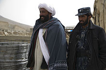 Abdul Samad, left, a recently reintegrated Taliban commander, and Afghan policeman Nic Mohammed, the commander of the Afghan Local Police in Khas Uruzgan, inventory supplies in Khas Uruzgan district, Uruzgan 120304-N-JC271-051.jpg