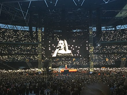 Adele at Wembley Stadium in June 2017. Adele's concert on 28 June was attended by 98,000 fans, a stadium record for a UK music event. Adele Live 2017 - The FINALE - WEMBLEY Stadium - LONDON - Make You Feel My Love (night 2, June 29th).jpg