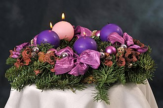 Gaudete Sunday - One of the candles surrounding the Christ Candle in the Advent wreath is rose coloured for Gaudete Sunday, the beginning of the third week in Advent.