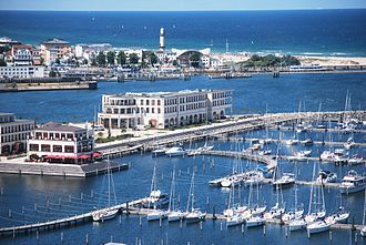 "Yacht club - Aerial view of yacht club and marina Yacht Harbour Residence ""Hohe Düne"" in Rostock, Germany."