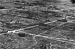 Aerial view of streets in Nagoya, Japan, in August 1945.jpg