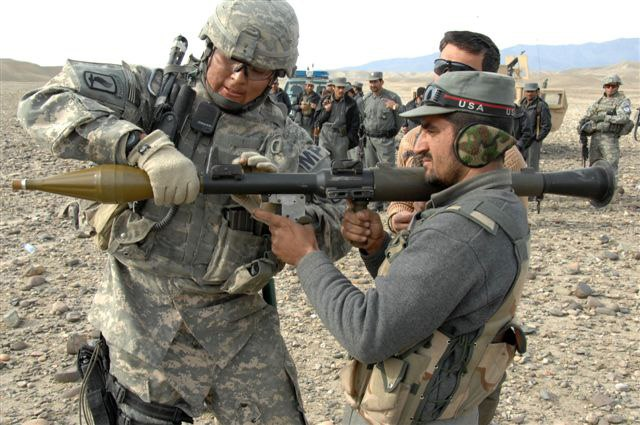 Afghan National Police officer ready to fire an RPG round at a training site
