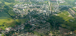 Aerial view of Ahrensfelde (foreground) with Berlin-Marzahn housing estates (background)
