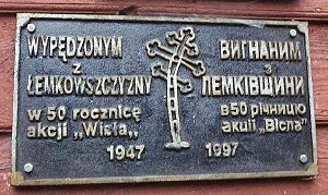 "Operation Vistula - Inscription in Polish and Ukrainian at a church in Beskid Niski, Poland: ""In memory of those expelled from Lemkivshchyna, on the 50th anniversary of 'Operation Vistula,' 1947-1997."""