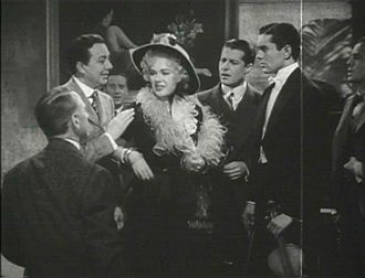 Alice Faye - Alice Faye (center) with Jack Haley (left), Don Ameche, and Tyrone Power (right), in a trailer for Alexander's Ragtime Band (1938)