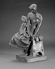 Mother and child sitting on a tabouret; the child is holding the mother's right arm