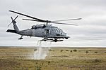 An HH-60 Pave Hawk helicopter from the 210th Rescue Squadron takes off after loading simulated casualties during exercise Arctic Chinook (29396128462).jpg