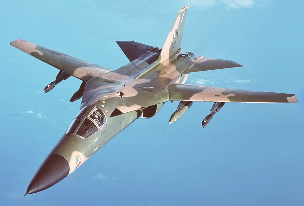 An air-to-air left front view of an F-111 aircraft during a refueling mission over the North Sea DF-ST-89-03609 (altered)
