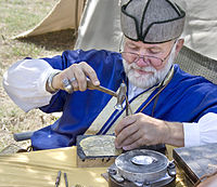 Ancient Hungarian - traditional coppersmith master at work.jpg